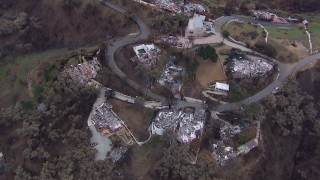 CAP_018_046 - HD stock footage aerial video a bird's eye view and orbit of homes destroyed by fire, Malibu, California