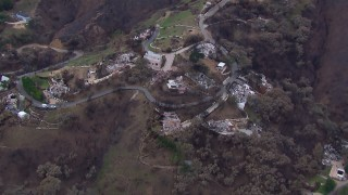 CAP_018_047 - HD stock footage aerial video orbit and fly away from homes destroyed by fire, Malibu, California