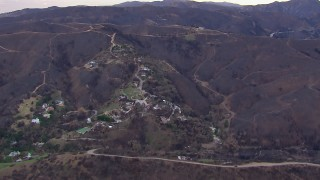 CAP_018_048 - HD stock footage aerial video of a reverse view of homes destroyed by fire, Malibu, California