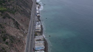 CAP_018_059 - HD stock footage aerial video of oceanfront homes by PCH at sunset, Malibu, California