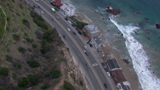 CAP_018_061 - HD stock footage aerial video of light traffic on PCH at sunset and Malibu homes, California