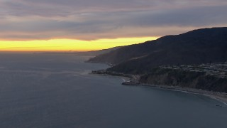 CAP_018_062 - HD stock footage aerial video of a reverse view of Malibu at sunset, California