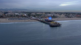CAP_018_069 - HD stock footage aerial video orbit the end of Santa Monica Pier and Ferris wheel at sunset, California