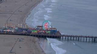 CAP_018_071 - HD stock footage aerial video of orbiting the Ferris wheel at Santa Monica Pier at sunset, California