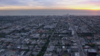 CAP_018_076 - HD stock footage aerial video of Santa Monica and the ocean at sunset, California