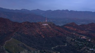CAP_018_077 - HD stock footage aerial video of approaching the Hollywood Sign at sunset, California