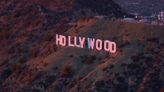 CAP_018_083 - HD stock footage aerial video of orbiting the famous Hollywood Sign at sunset, California