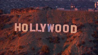 CAP_018_084 - HD stock footage aerial video of a close-up view of the famous Hollywood Sign at sunset, California