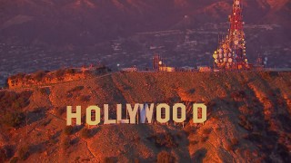 CAP_018_085 - HD stock footage aerial video of flying away from the famous Hollywood Sign at sunset, California