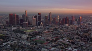 CAP_018_089 - HD stock footage aerial video of flying by the Downtown Los Angeles skyline at sunset, California