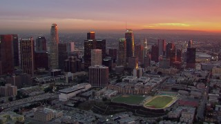 CAP_018_090 - HD stock footage aerial video of passing by the Downtown Los Angeles skyline at sunset, California