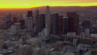 CAP_018_093 - HD stock footage aerial video of flying away from and past the Downtown Los Angeles skyscrapers at sunset, California