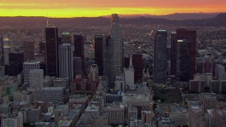CAP_018_094 - HD stock footage aerial video of flying by US Bank Tower and Downtown Los Angeles skyscrapers at sunset, California