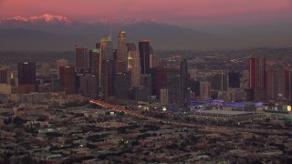 CAP_018_101 - HD stock footage aerial video of flying by Downtown Los Angeles skyscrapers at sunset, California