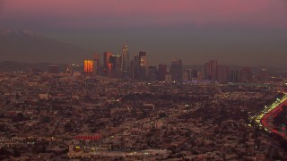 CAP_018_104 - HD stock footage aerial video of a wide view of the Downtown Los Angeles skyline at sunset, California