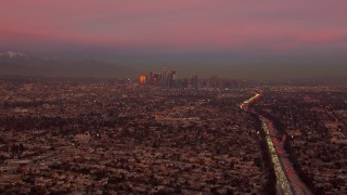 CAP_018_105 - HD stock footage aerial video of a view of the distant Downtown Los Angeles skyline at sunset, California