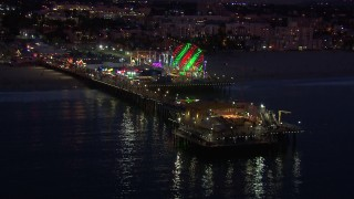 CAP_018_110 - HD stock footage aerial video of flying toward the end of Santa Monica Pier and Ferris wheel at twilight, California