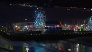 CAP_018_113 - HD stock footage aerial video of the Ferris wheel and rides at night, Santa Monica Pier, California