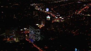 CAP_018_125 - HD stock footage aerial video of approaching the Sunset Strip at night in West Hollywood, California