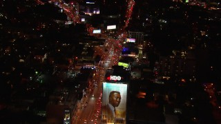 CAP_018_127 - HD stock footage aerial video fly over billboard for view of traffic on the Sunset Strip at night in West Hollywood, California
