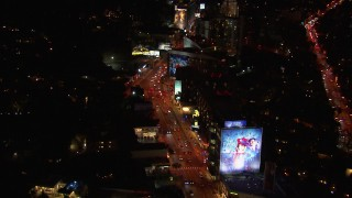 CAP_018_130 - HD stock footage aerial video of flying over the Sunset Strip at night in West Hollywood, California