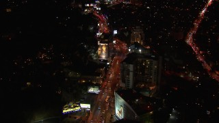CAP_018_131 - HD stock footage aerial video of light traffic on the the Sunset Strip at night in West Hollywood, California