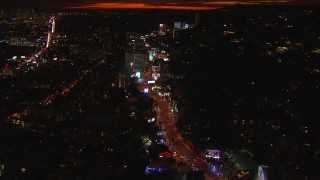 CAP_018_138 - HD stock footage aerial video flying toward Sunset Strip, billboards and traffic at night in West Hollywood, California