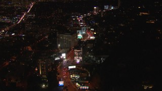 CAP_018_139 - HD stock footage aerial video flying over Sunset Strip, billboards and traffic at night in West Hollywood, California