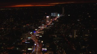 CAP_018_142 - HD stock footage aerial video tilt for a view of Sunset Strip billboards and traffic at night in West Hollywood, California