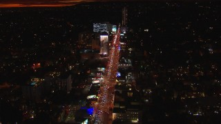 CAP_018_143 - HD stock footage aerial video approach Sunset Strip billboards and traffic at night in West Hollywood, California