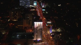 CAP_018_144 - HD stock footage aerial video fly over cars lining Sunset Strip at night in West Hollywood, California