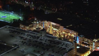 CAP_018_146 - HD stock footage aerial video of a Christmas tree at The Grove shopping mall at night in Los Angeles, California
