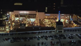 CAP_018_147 - HD stock footage aerial video of orbiting a Christmas tree at The Grove shopping mall at night in Los Angeles, California