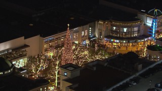 CAP_018_148 - HD stock footage aerial video of circling a Christmas tree at The Grove shopping mall at night in Los Angeles, California