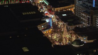 CAP_018_149 - HD stock footage aerial video of an orbit around a Christmas tree at The Grove shopping mall at night in Los Angeles, California