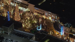 CAP_018_151 - HD stock footage aerial video of circling a fountain at The Grove shopping mall at night in Los Angeles, California