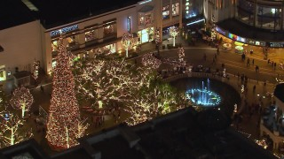 CAP_018_152 - HD stock footage aerial video of orbiting a fountain at The Grove shopping mall at night in Los Angeles, California