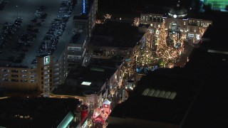 CAP_018_153 - HD stock footage aerial video of orbiting The Grove shopping mall at night in Los Angeles, California