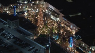 CAP_018_154 - HD stock footage aerial video of orbiting The Grove shopping mall, decorated for the holidays, at night in Los Angeles, California