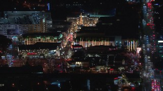 CAP_018_158 - HD stock footage aerial video of a view of The Grove shopping mall, decorated for the holidays at night in Los Angeles, California