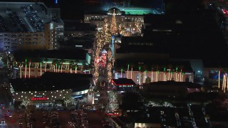CAP_018_159 - HD stock footage aerial video approach The Grove shopping mall, decorated for the holidays at night in Los Angeles, California