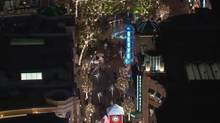 CAP_018_161 - HD stock footage aerial video of holiday decorations and fountain at The Grove shopping mall at night in Los Angeles, California