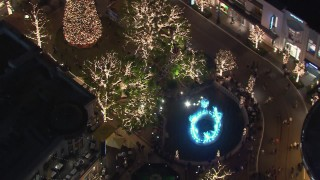 CAP_018_162 - HD stock footage aerial video of Christmas decorations and fountain at The Grove shopping mall at night in Los Angeles, California