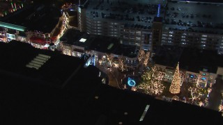 CAP_018_164 - HD stock footage aerial video of circling Christmas decorations and fountain at The Grove shopping mall at night in Los Angeles, California