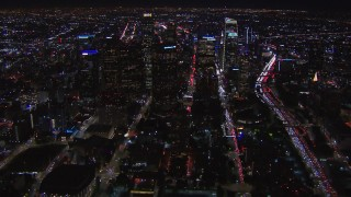 CAP_018_173 - HD stock footage aerial video of flying past the city's skyline at night in Downtown Los Angeles, California