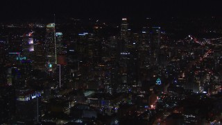 CAP_018_182 - HD stock footage aerial video of an orbit of the city's skyline at night in Downtown Los Angeles, California