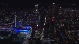 CAP_018_184 - HD stock footage aerial video flyby Staples Center and the city's skyline at night, Downtown Los Angeles, California