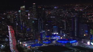 CAP_018_186 - HD stock footage aerial video of Staples Center and the city's skyline at night, Downtown Los Angeles, California