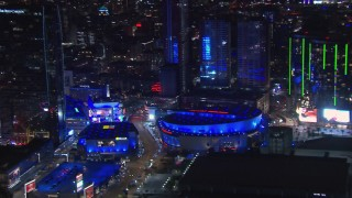 CAP_018_188 - HD stock footage aerial video of panning to Staples Center at night, Downtown Los Angeles, California