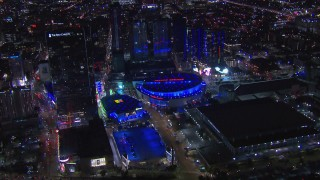 CAP_018_189 - HD stock footage aerial video of zooming to arena and theater at night, Downtown Los Angeles, California